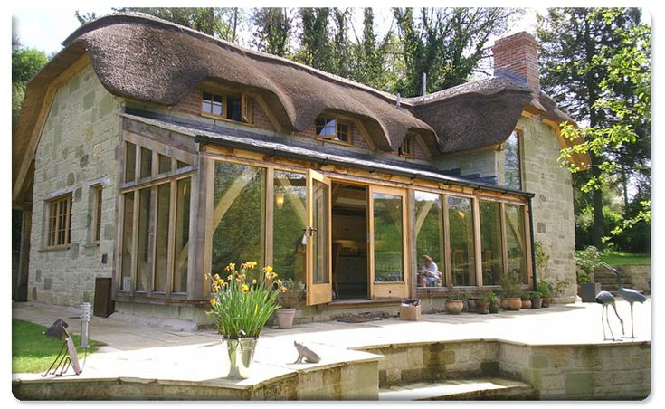 Click here to enlarge this image of Greenstone Thatch Cottage with Oak conservatory in Donheads, Shaftesbury Dorset