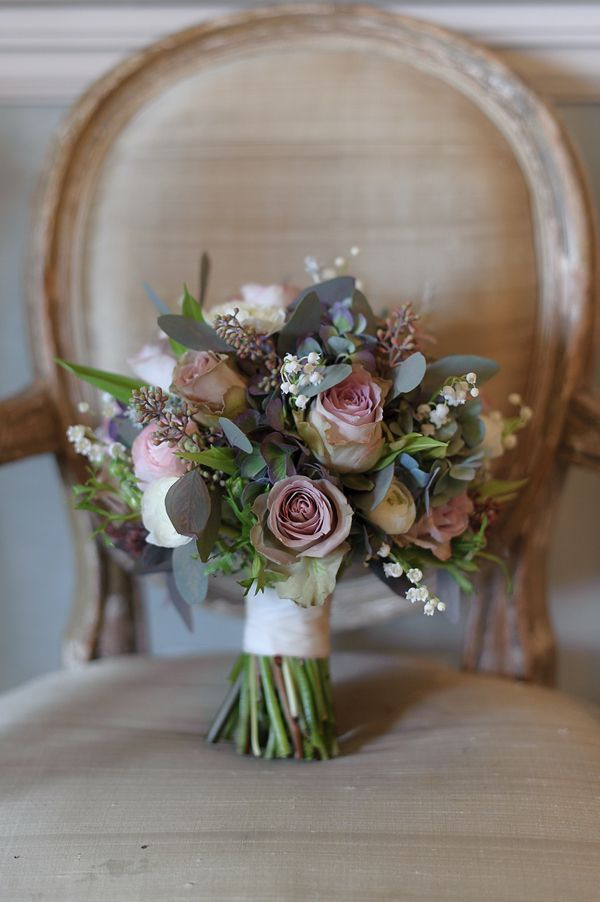 Bouquet with two types of roses, ranunculus, lilly of the valley, hydrangea and eucalyptus