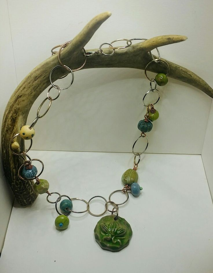 I used the fabulous beads sent to me by Leanne Loftus of 1st Impression Designs to make this necklace.  I added some of my handmade torch fired beads and headpins.