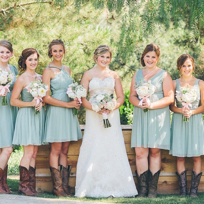 Mismatched dusty shale bridesmaids dresses with cowboy boots | 559 Photography