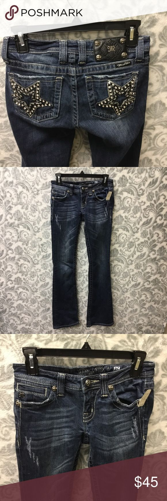 Miss Me Bootcut star embellished jeans size 25 Excellent condition (any fading/rips/distressed look was done by the designer)  Awesome star design on back  No wear in crotch  PRICE IS FIRM UNLESS BUNDLED  If you have any questions or need any measurements not included in the pictures, please feel free to ask ❤️   Bundle and save 💙 Miss Me Jeans Boot Cut