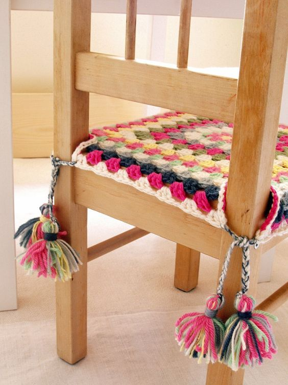 Fun crochet seat covers for the kitchen table. Maybe (Granny square chair cover with tassels):