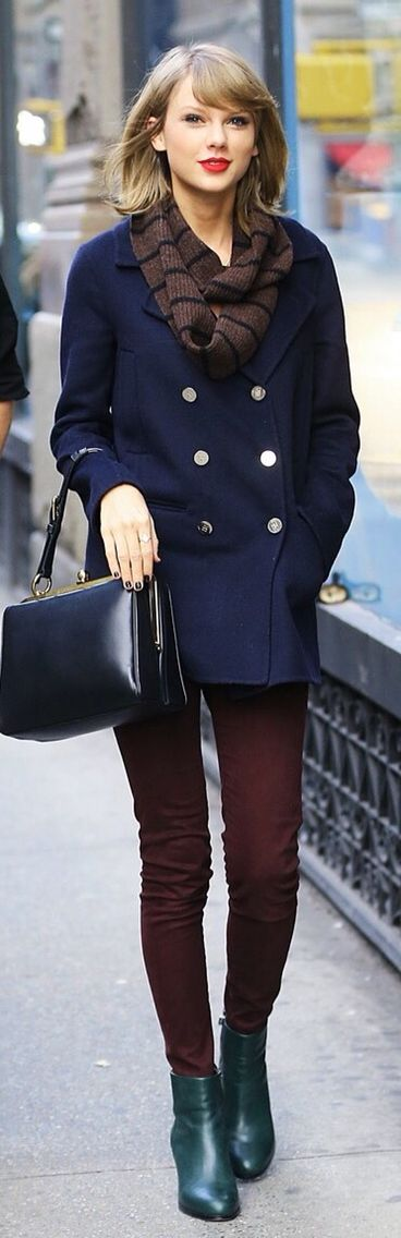 Taylor Swift shows her signature chic in navy coat and striped scarf