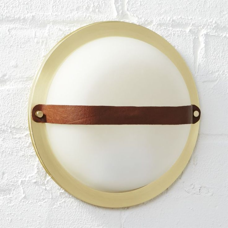 ship to shore. Classic ship portholes shine anew in this modern maritime design by Mermelada Estudio. Inspired by iconic ship windows, ours is made modern in brushed brass with a sophisticated leather strap.  A smart space-saver, sconce is perfect for flanking the bathroom mirror, illuminating a small entry or lined in the hallway. Learn about Mermelada Estudio on our blog.