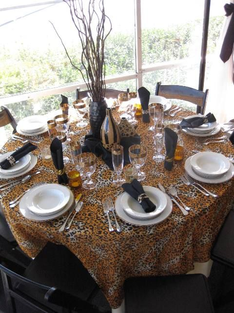 Safari Linen Display with cheetah print. This shows how versatile white dishes can be!