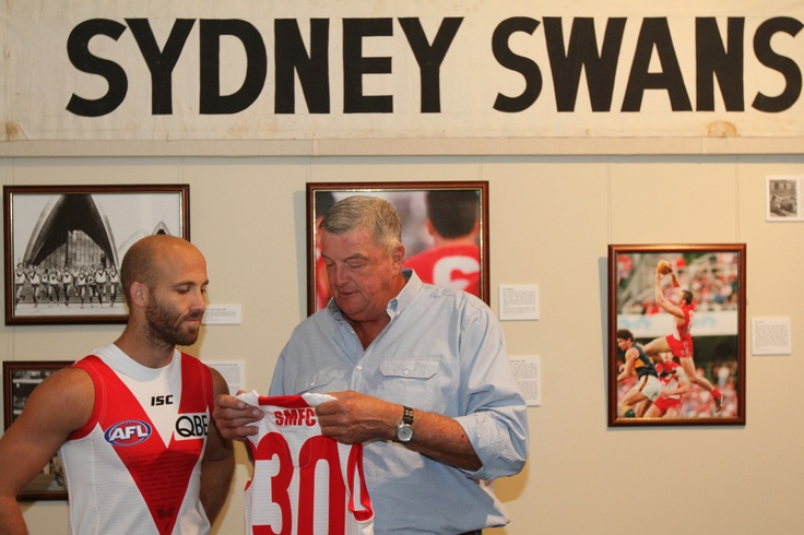 Swans co-captain Jarrad McVeigh and inaugural captain Barry Round with the Swans 30 Years in Sydney commemorative guernsey.
