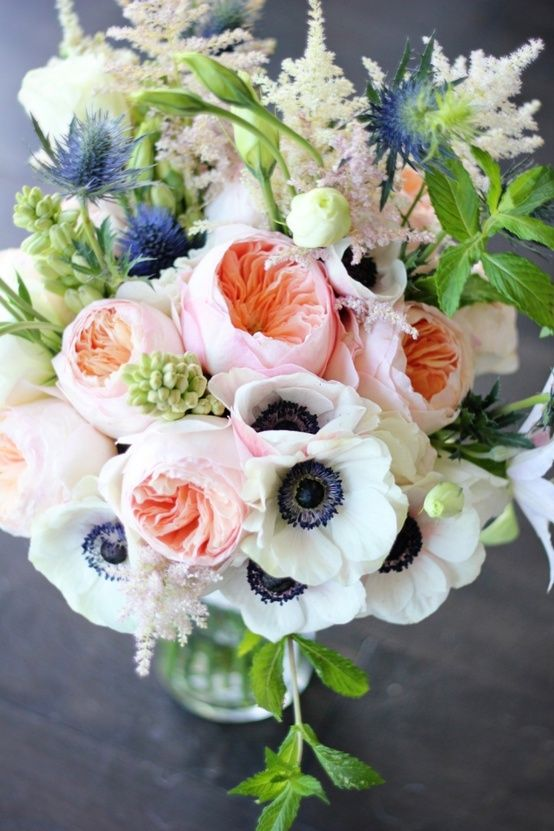 Garden Rose wedding bouquet: roses, anemones, pink and white astilbe, lisianthus, thistle, tuberose and mint.