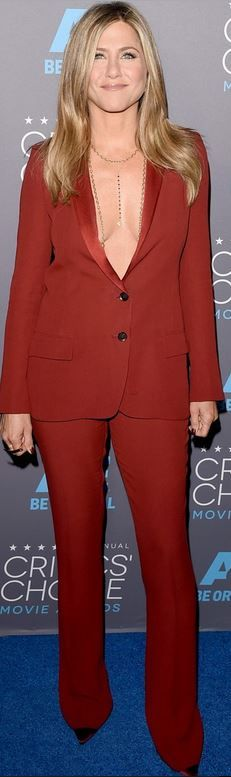 Jennifer Aniston: Pants and jacket – Gucci  Shoes – Christian Louboutin  jewelry – Fred Leighton and Amrit