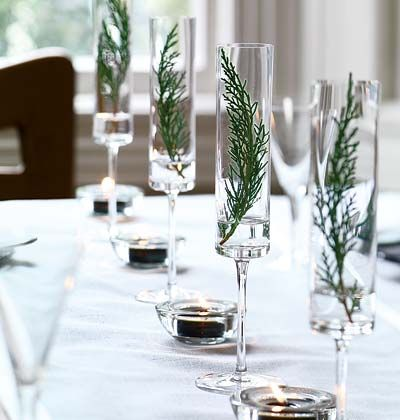 Table statements - Champagne glasses filled with water and little branches of evergreens (Photo by Thomas J. Story) - via myhomeideas