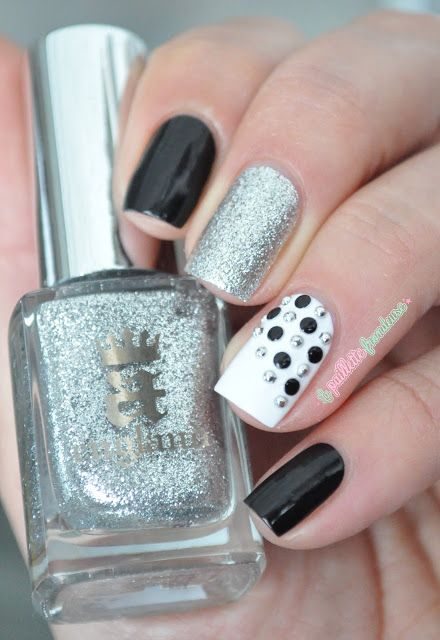 Black and white studs nail art with silver accent                                                                                                                                                                                 Plus
