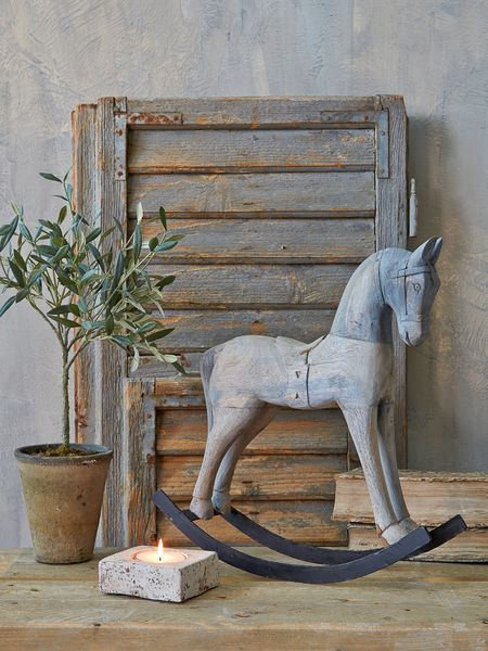 With all the charm of a one-off antique find, our adorable wooden rocking horse has a naturally aged grey finish and an authentic hand-crafted feel.