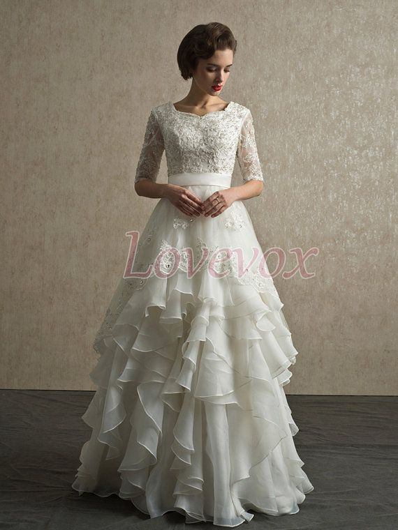 Lace wedding dress with half sleeves appliqued beaded for Tiered wedding dress with sleeves