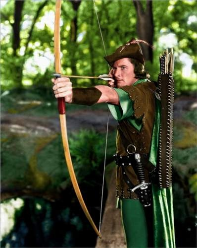 "Errol Flynn, bringing color to an increasingly pallid world in 1938's technicolor masterpiece, ""The Adventures of Robin Hood""  My husband's favorite actor  June 20th is his birthday"