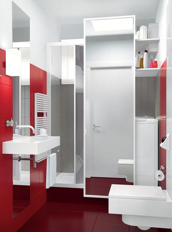 Washing machine behind the mirror in a small bathroom