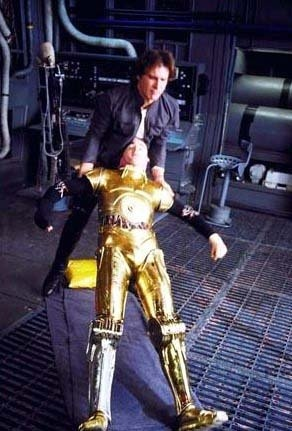 Harrison Ford helping Anthony Daniels stand up after a break during filming of Star Wars The Empire Strikes Back
