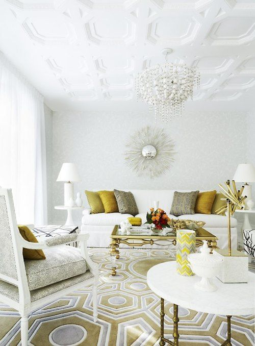 White living room with silver and gold accents.
