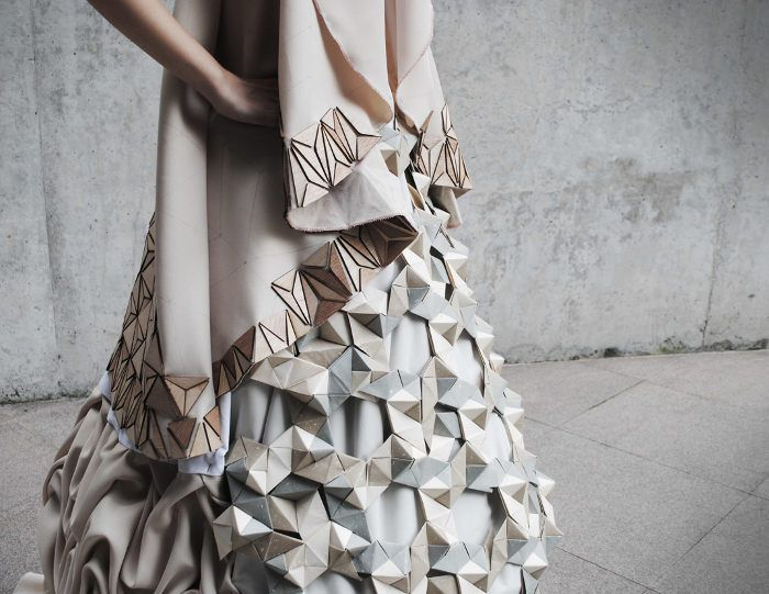Textiles, paper & wood dress with geometric shapes & juxtaposed textures; innovative fashion design // Gillian Toh & Alice Allis