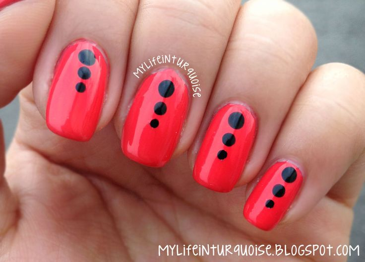 red nail with black dots