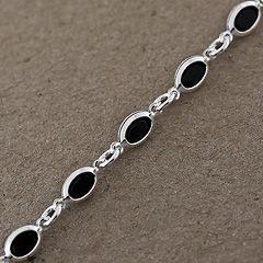 Bransoletka srebrna z czarnymi oczkami.