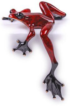 Frogman bronze sculpture from Dad.  Love how his leg hangs over edge of shelf.