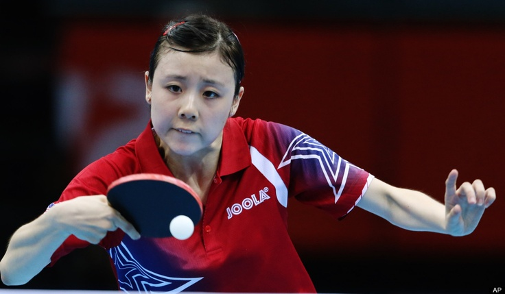 Ariel Hsing of the United States competes against Li Xiaoxia of China during their women's table tennis match at the 2012 Summer Olympics, Sunday, July 29, 2012, in London.