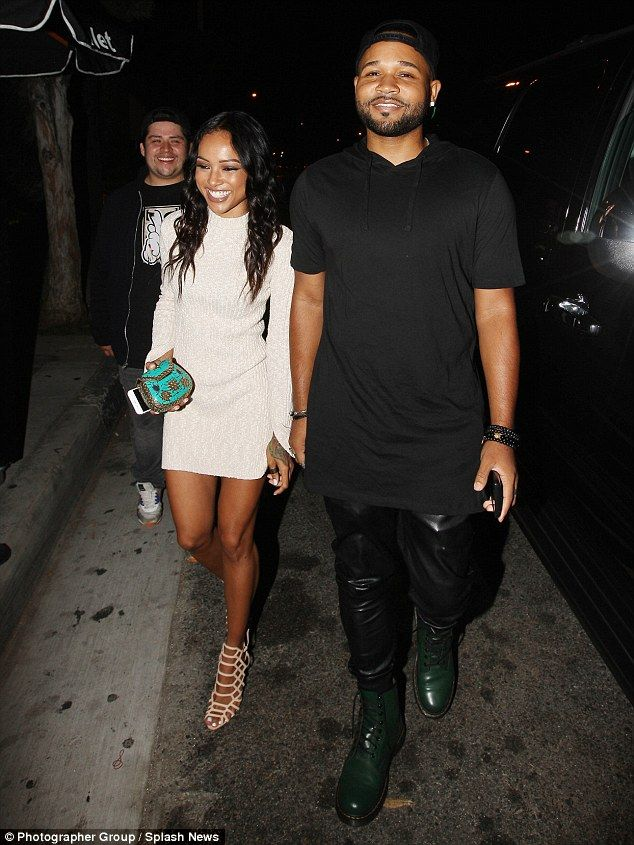 Not letting it get to her: Karrueche tried to enjoy herself as she stepped out following a threat made to her friend Marques Houston after he praised her derriere on Instagram