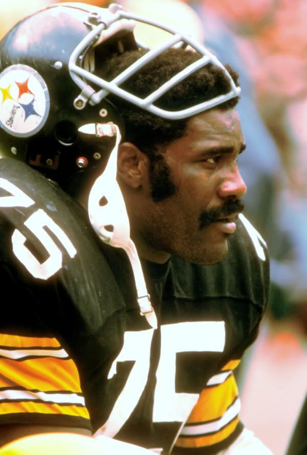 "Charles Edward Greene, known as ""Mean Joe"" Greene, (born September 24, 1946) is a former all-pro American football defensive tackle who played for the Pittsburgh Steelers of the NFL. Throughout the early 1970s he was one of the most dominant defensive players in the NFL . He is considered by many to be one of the greatest defensive linemen ever and was the cornerstone of the legendary ""Steel Curtain"" defense.He is a member of the Pro Football Hall of Fame and a four-time Super Bowl champion"