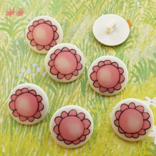ピンクのお花のボタン