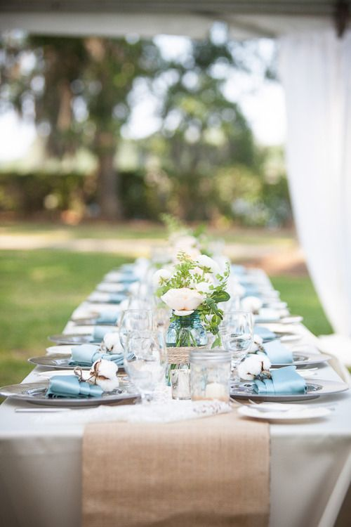 white table cloth baby blue napkins and burlap table runners