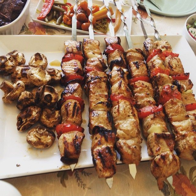 Shashlik and barbecued mushrooms. An enormous Russian skewer. Pork + red peppers + onions.