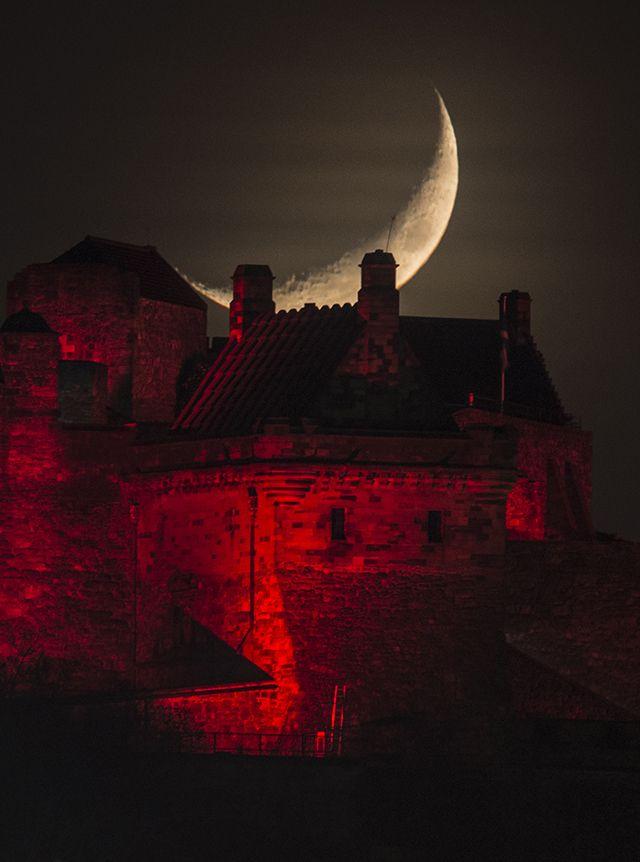 Moon and Edinburgh Castle very close