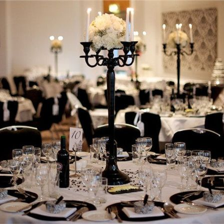 Black candelabras are a must. Don't like the flowers in a tight ball tho
