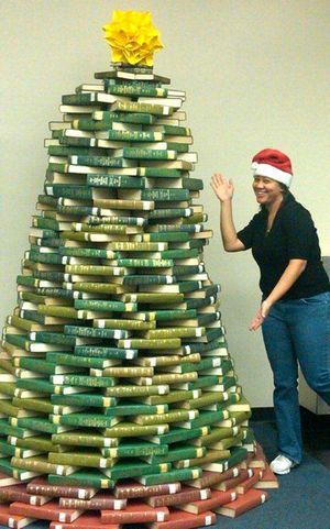 Christmas tree made of books at Inglewood library. This is too cool. What a great idea for all our older green hymnals and red pew Bibles.