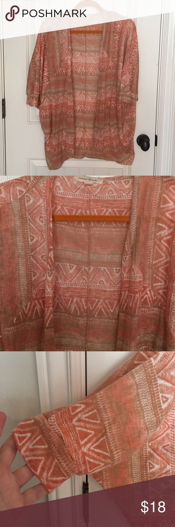 Woman's cardigan This is a beautiful cardigan.  It is perfect weight, flow and perfect color ( coral $& white) for Spring & Summer!  It looks so cute with cropped white jeans & cute sandals or wedges!  Very versatile dress up or down.  Very fun Aztec design on it.  Dress it up for an evening date or night out but light enough to wear all day, even in Summer.  Bought at Boutique.  Size M.  Could probably fit a bit bigger too!  Really fun & pretty 😊❤$18 MINT! Tops