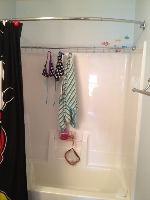 I just did this today. Found here on Pinterest a while back and thought what a neat idea since we use our pool almost everyday in the warmer months.  Just buy a shower rod, this one is a tension one and then I used the hooks to hang the curtain on, as hooks for the wet suits and towels instead.