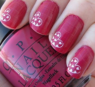 This is two coats of OPI Hoodoo Voodoo?!, a great bright berry creme.  Silky smooth application, great coverage and drying!  I used OPI Chapel of Love and Konad m60 to add the faint light pink plaid design in the background, and Konad Special White with Konad plate m59 to add the hearts.
