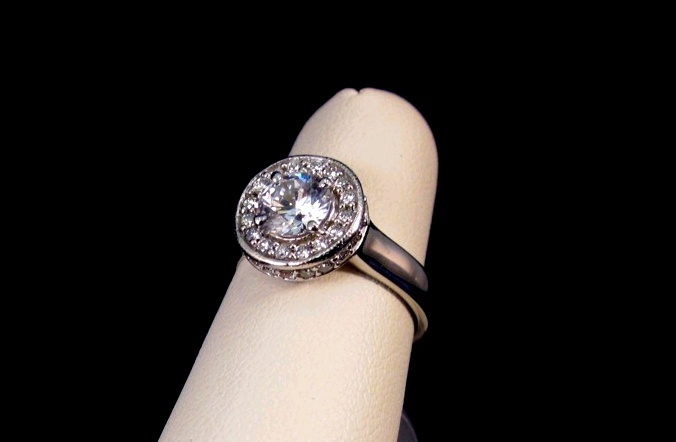 Bezel-set Halo Diamond Ring in 14k white gold. Diamonds around rim of mounting. From Frank Reubel.