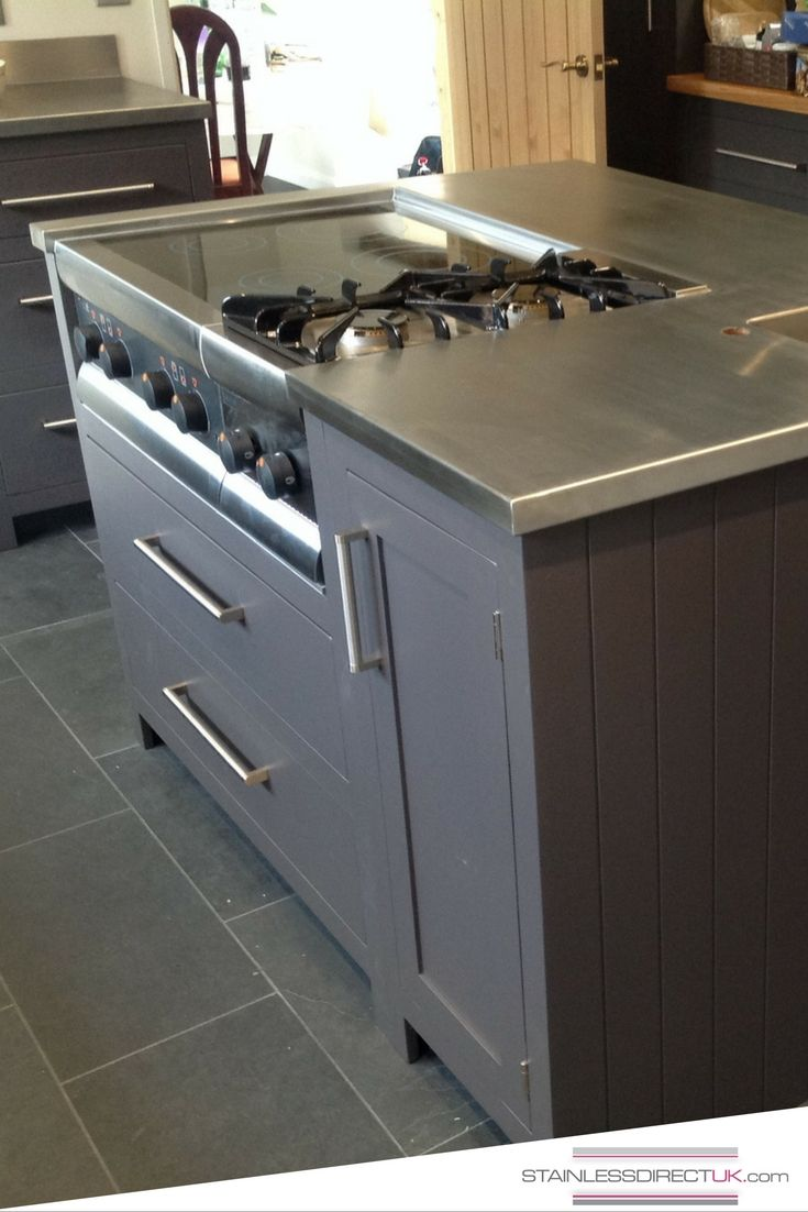 Stainless steel kitchen work surfaces - This Homeowner Decided On A Mix Of Wood And Stainless Steel For His Kitchen Worktops And