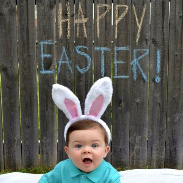 My little man's Easter pic. Some sidewalk chalk on the fence, bunny ears from the dollar section at target, a blanket, and of course his cute little self :)