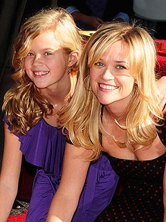 Actress, Reese Witherspoon, and her daughter Ava share the same playful smile