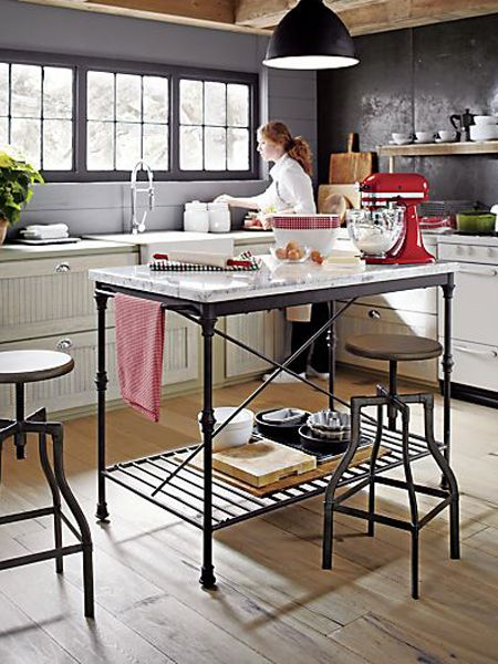 Crate and Barrel French patisserie table in black iron, with white marble top (polished Carrara) | House & Home