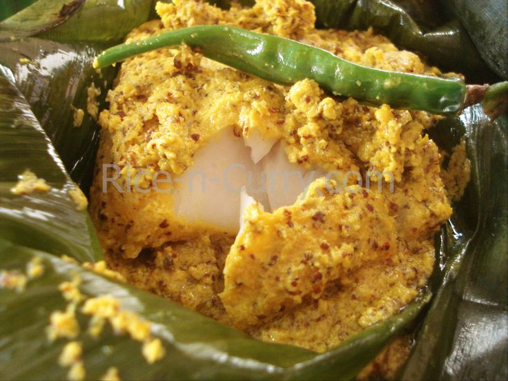 Bhetki Paturi - fish mixed with spices and mustard and cooked in a banana leaf