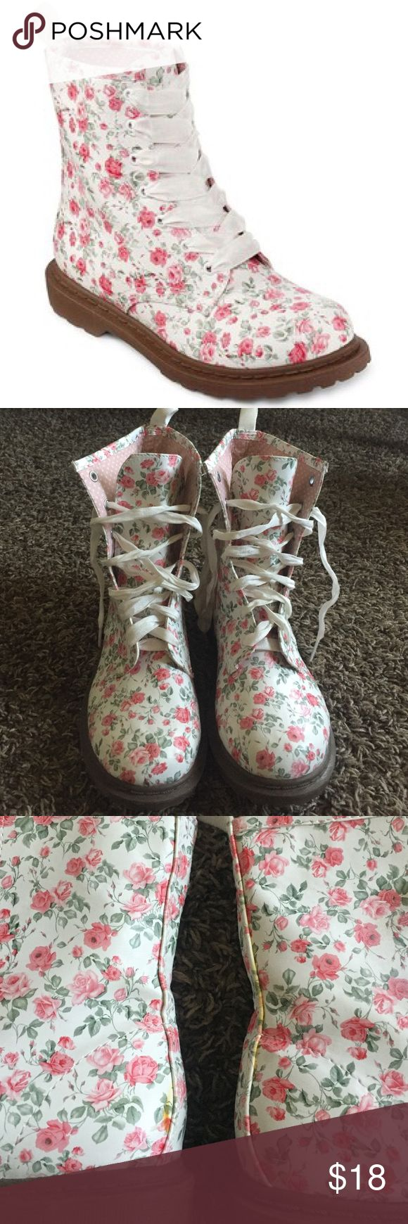 Floral combat bootsLAST DROP PRICE Super cute combat boots with lots of pink flowers, really good condition. It has some scratch on one of them but you can't barely notice it. They have some yellow stuff on the back as showed on pic. It might me blue. Arizona Jean Company Shoes Combat & Moto Boots