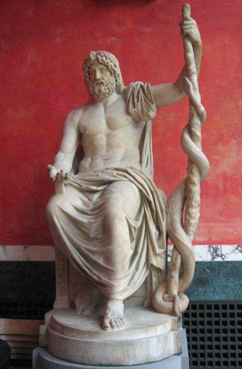 Estatua de Asclepio, dios griego de la Medicina, empuñando la simbólica vara de Asclepio, con la serpienta enrollada.