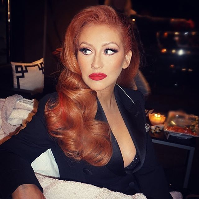 Christina Aguilera debuts bold red hair in pinup curls at an event for Hillary Clinton. Get the details!