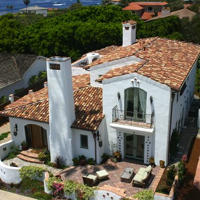 In addition to their intrinsic beauty, tile roofs are extremely durable, lasting for centuries in some cases.  Whether made of clay or concrete (the latter is more colorfast), individual tiles are often molded in barrel shapes for interlocking installation. Weight will be an issue, so be sure ask a structural engineer if your roof framing will support a tile application.