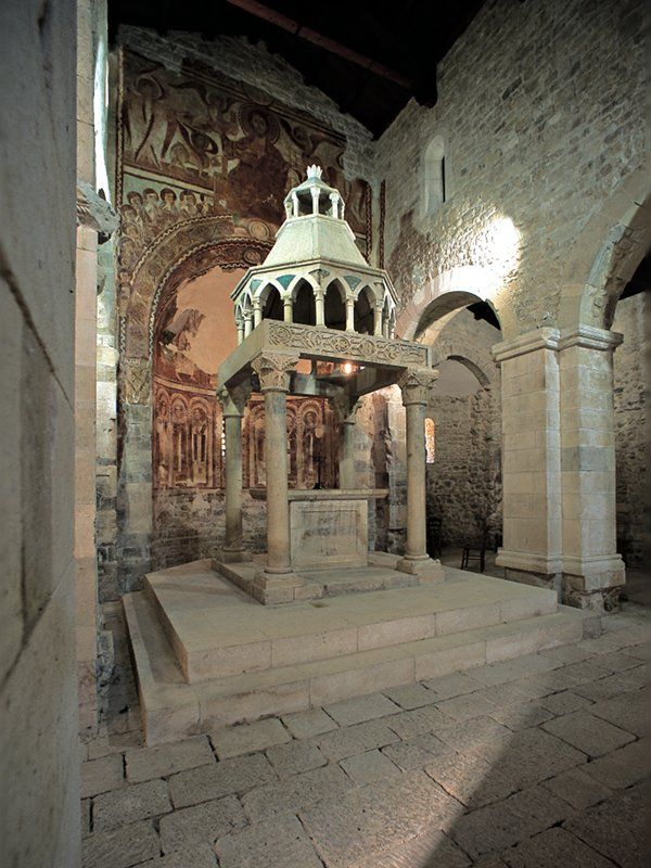 """Capestrano nel Aquila, Abruzzo - The Church of St. Peter ad Oratorium was built at the behest of the Lombard king, Desiderio. Its construction dates back to 752, when it is mentioned as a possession of the Benedictine monks of San Vincenzo al Volturno. The Lombard period are visible traces of some reliefs placed above the portal. Also of considerable importance is the word palindrome of """"Sator Square""""."""