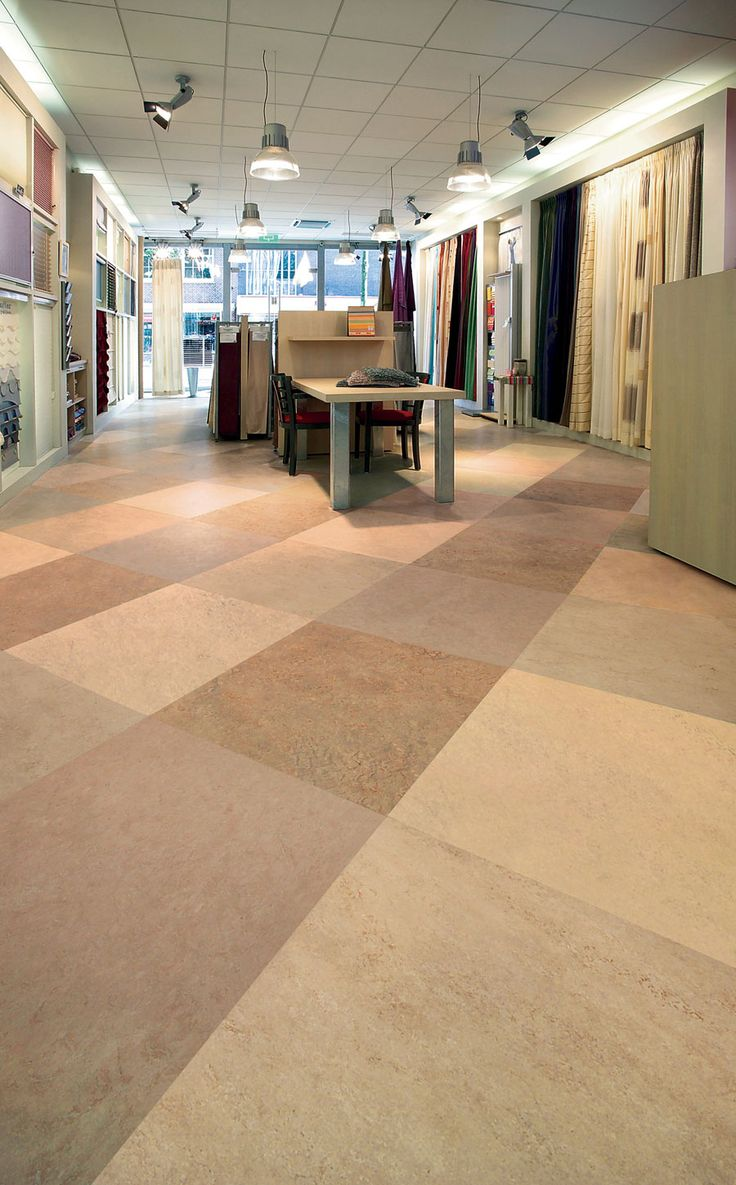 Try similar look with VCT by combining 4 or more of same color to create look of larger tile!