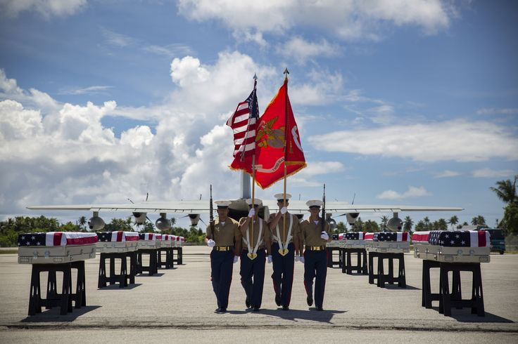 https://flic.kr/p/vKrfAC | Coming Home | A 3rd Marine Regiment color guard takes its place, July 25, 2015, during a repatriation ceremony in Tarawa, Kiribati. The ceremony honored the remains of approximately 36 Marines who fought and died during the Battle of Tarawa during World War II, and were loaded onto a C-130J Hercules aircraft to be transported back home to the United States.   (U.S. Marine Corps photo by Cpl. Matthew J. Bragg/Released)