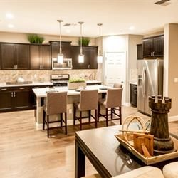 A great room is the perfect common space at Meadowood by Benchmark Communities. Luxury new homes in Fresno, CA.